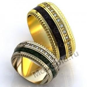 Необычные кольца с зеленой эмалью