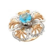 Кольцо с цветком и топазом